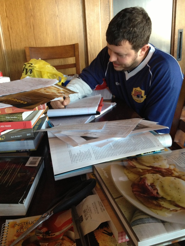 Chef Adam hammering out menus...