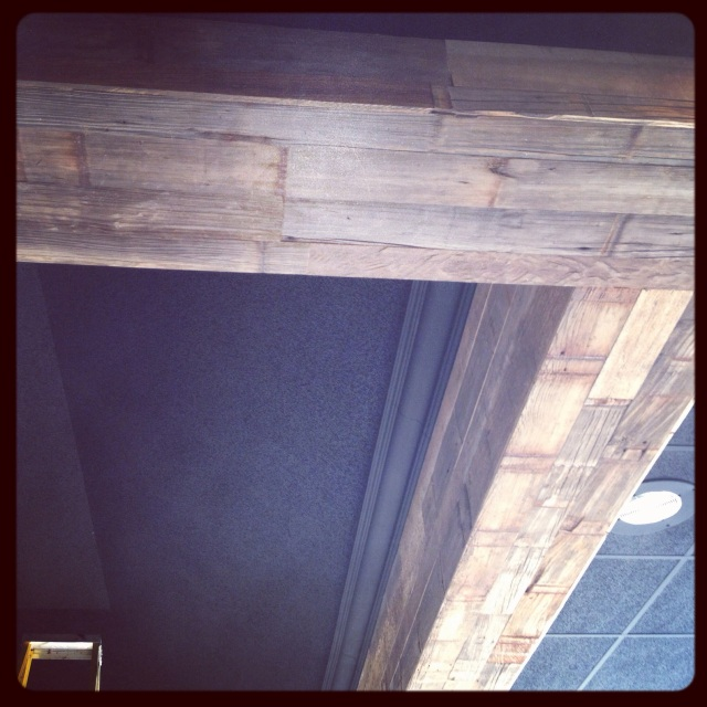 The ceiling once cloudy and grey is now wrapped with this beautiful repurposed wood from Urban Evolutions in Appleton.