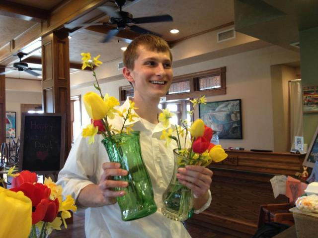 Server Riley getting flowers together for vases on Mother's Day 2013, Riley does it all...even payroll!